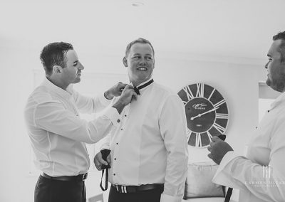 James and Lou historic Clifton House Young groom getting ready