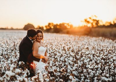 Michael Taleasha bride and groom in a cotton field
